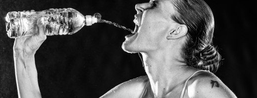Thirsty Sporty Woman Drinking Water from a Bottle